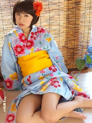 Rio Matsushita Asian shows sexy legs under geisha dress outdoor