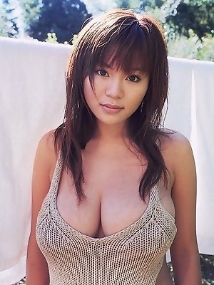 Yoko Matsugane Asian with immense cans shows curves in lingerie