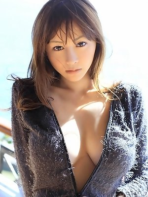 Anri Sugihara Asian shows big boobs in smiling boobs on the beach