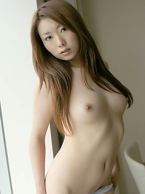 Hot Japanese babe has nice firm tits and a hairy pussy she likes showing foo