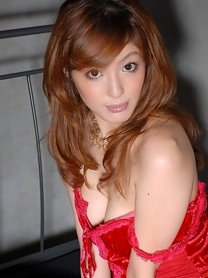 Japanese fuck doll is perfect in red lingerie, thigh highs and high heel sandals