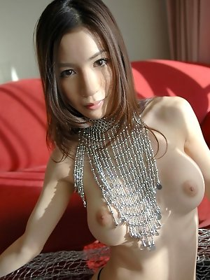 Japanese slut is naked showing off her shaved pussy and big tits for the cameras